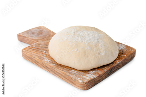 Wooden board with raw dough on white background Fototapeta