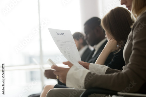 multiracial business people waiting in queue preparing for job