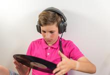 Boy Listening To A Vinyl On White Background