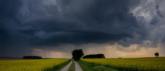 approaching storm over a country road