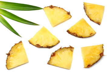 healthy background. pineapple slices with green leaves isolated on white background top view