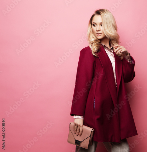 Fashion, people and lifestyle concept: Beautiful woman long blond curly hair wear cashmere coat and holding handbag Fototapeta