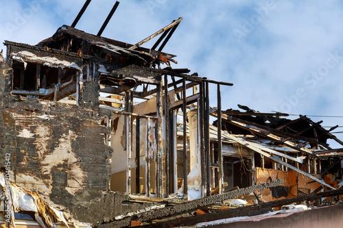 Fototapeta Village house after the fire Dramatic landscape after fire obraz