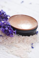 Obraz na płótnie Canvas makeup base, bath salt and lavender on white wood table background