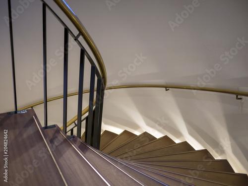 Foto op Canvas Trappen Staircase with copper handrail