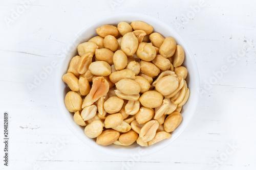 Photo Erdnüsse Nüsse von oben Holzbrett