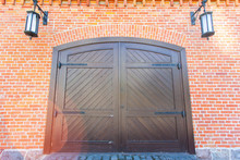 Large Wooden Gate In A Brick W...