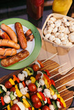Hot sausages and vegetables with mushrooms on skewers grilled for outdoors barbecue