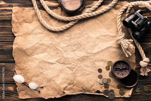 Photo Stands Ship top view of blank crumpled paper with compass, binoculars and rope on rustic wooden surface