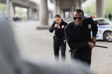 Multiethnic Police Officers Ru...
