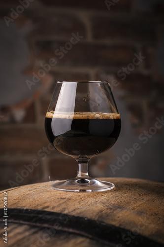 Fotobehang Bier / Cider Glass of barrel aged stout