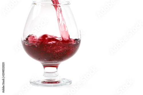 Staande foto Bar A fine red strong wine is poured into a transparent glass