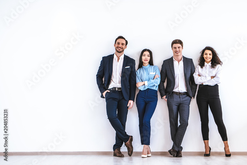 Fényképezés  The business people standing on the white wall background