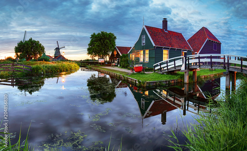 Traditional dutch windmill near the canal Wallpaper Mural