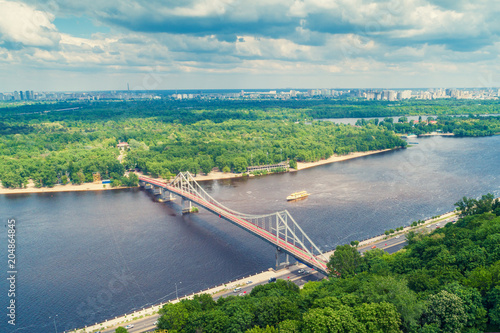 Spoed Foto op Canvas Kiev Skyline, Kiev city with beautiful sky. Left bank the Dnieper River. Pedestrian bridge