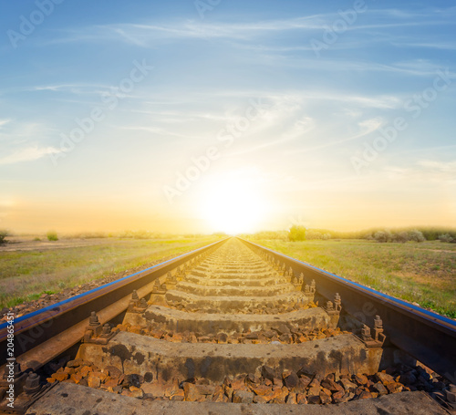 railway leaving far on a sunset background