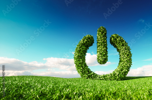 Eco friendly renewable energy concept. 3d rendering of green power button sign on fresh spring meadow with blue sky in background.