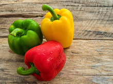 Fresh Green , Red And Yellow Bell Pepper On Wooden Background. Spices Vegetable