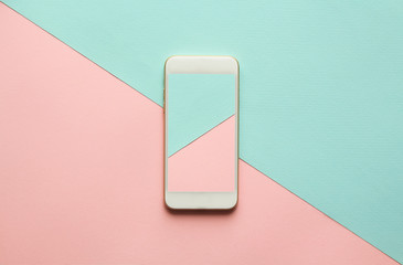 Blank screen white cellphone on diagonal pastel pink and blue background. Minimal concept, flatlay.