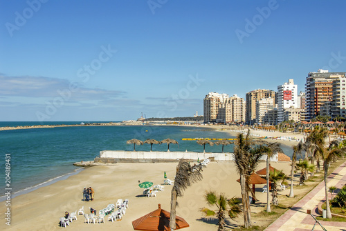 Alexandria, Egypt, 21 February 2018: View of Alexandria harbor, beach, palms and Canvas Print