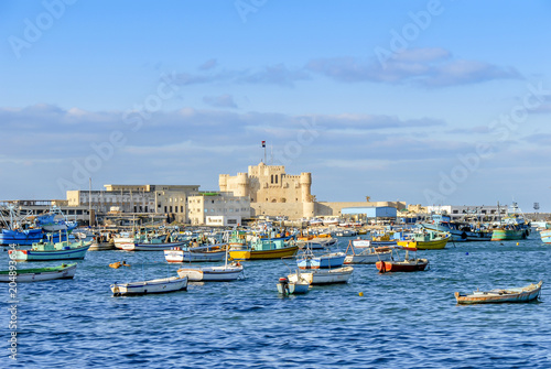 Alexandria, Egypt, 21 February 2018: Qaitbay Citadel and sandals Canvas Print