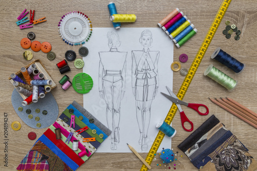 Fototapeta Creative Fashion Design desk with sketch and accessories