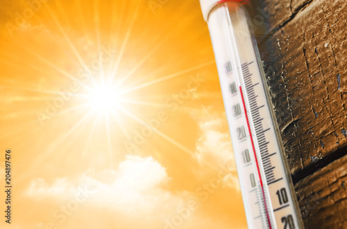 Fotografie, Obraz  Thermometer is hot in the sky, concept of hot weather.