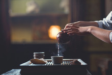 Female Hands Pouring Tea From ...