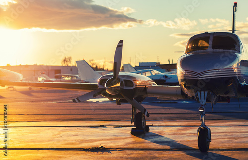 Small Aviation: Private Jet is Parked on a Tarmac in a Beautiful Fototapet