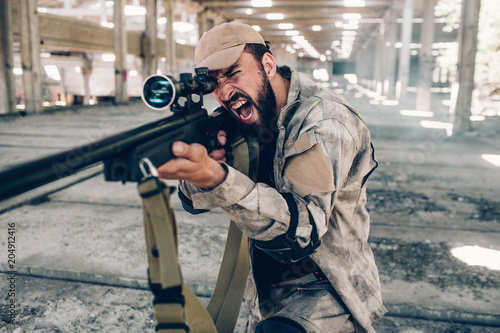 Horizontal View Of Military Soldier Screaming And Yelling