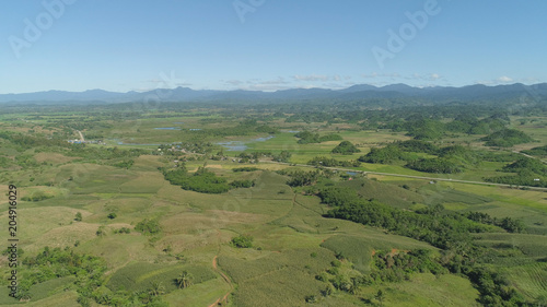 Poster Khaki Aerial view of rice terrace, agricultural land of farmers. Tropical landscape with farmlands on Luzon, Philippines. Rice fields against the blue sky.