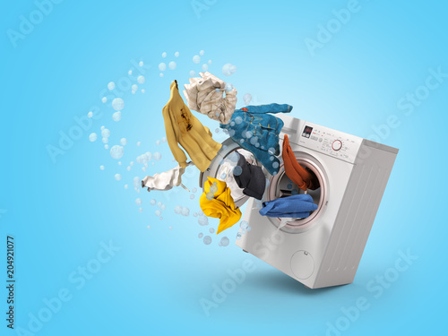 Fototapeta Washing machine and flying clothes on blue background