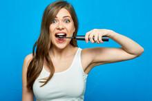 Woman Brushing Teeth With Elec...