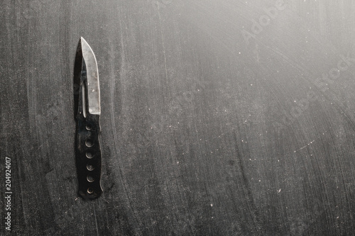 combat knife blade on dark backround Poster