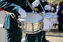 The Soldier In White Gloves Knocks On The Drum. A Military Band Plays Drums In The Army.