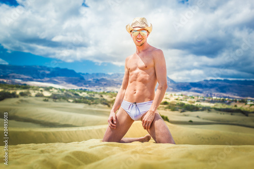 Foto op Plexiglas Crazy dog sexy gay man at the beach