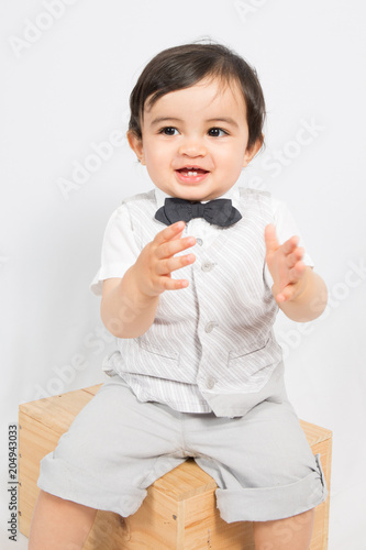 a boy in a shirt and bow tie sit on box ready to applaud Wallpaper Mural