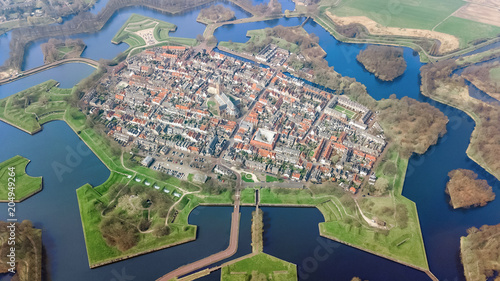 Foto op Aluminium Historisch geb. Aerial top view of Naarden city fortified walls in star shape and historic village in Holland, Netherlands