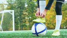 Boy Football Soccer Tying The ...