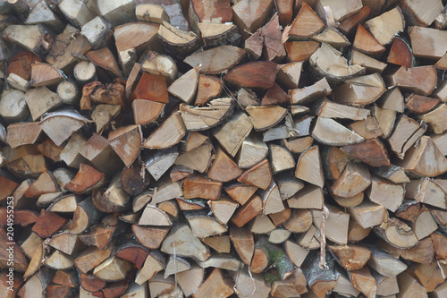 Poster Brandhout textuur Wood pile near country house