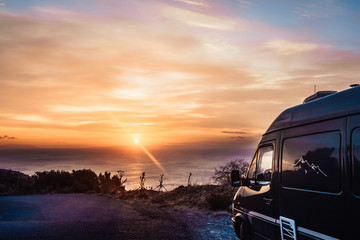 Camper car on nature at sunrise. Travel