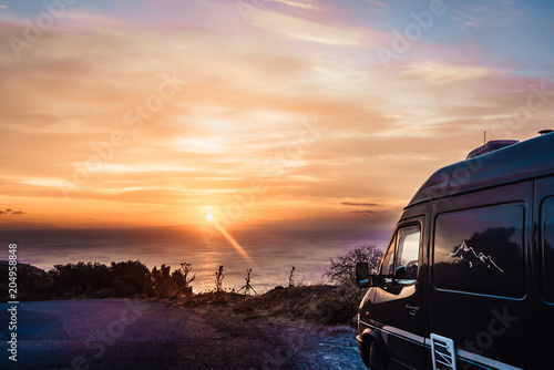 Canvas-taulu Camper car on nature at sunrise. Travel