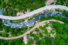 Aerial View  Over Mountain Road And Curves Going Through Forest Landscape
