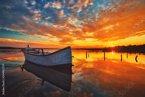 Photo sur Toile Orange eclat Small Dock and Boat at the lake