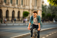 Young Man Bicyling On The Street