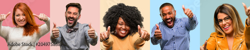 Obraz Cool group of people, woman and man stand happy and positive with thumbs up approving with a big smile expressing okay gesture - fototapety do salonu