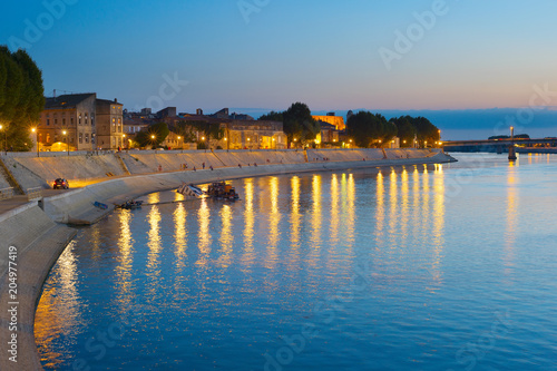 Canvas Print People walking embankment Arles, France