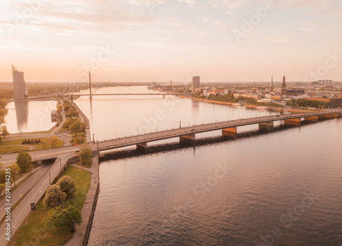 Poster Oceanië Beautiful aerial view of the Riga old town by the river Daugava and bridges over it. Panoramic Riga scene during sunset.