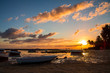 Lonely fishing boat at the coast of Mauritius island during sunrise.