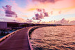 Beautiful sunset water villas on the sea connected by the bridge, Maldives